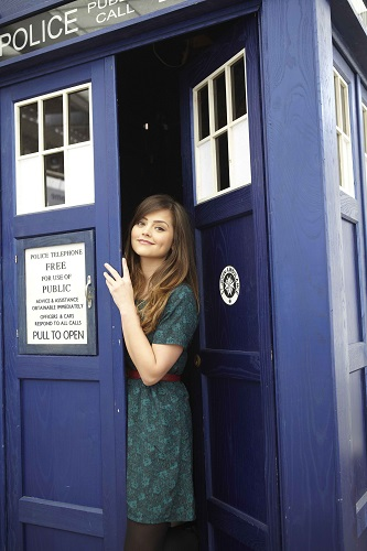Jenna Coleman in front of the TARDIS